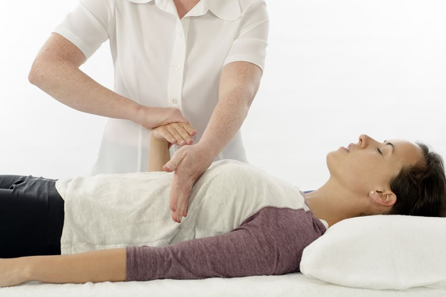 A Patient receiving Kinesiology treatment
