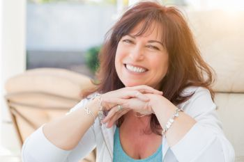 A happy middle aged woman after having received  bioidentical hormone replacement