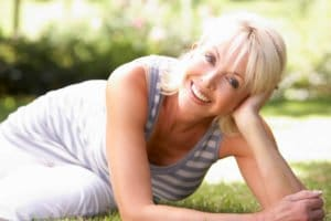 A happy woman who got rid of menopause symptoms thanks to our alternative therapies
