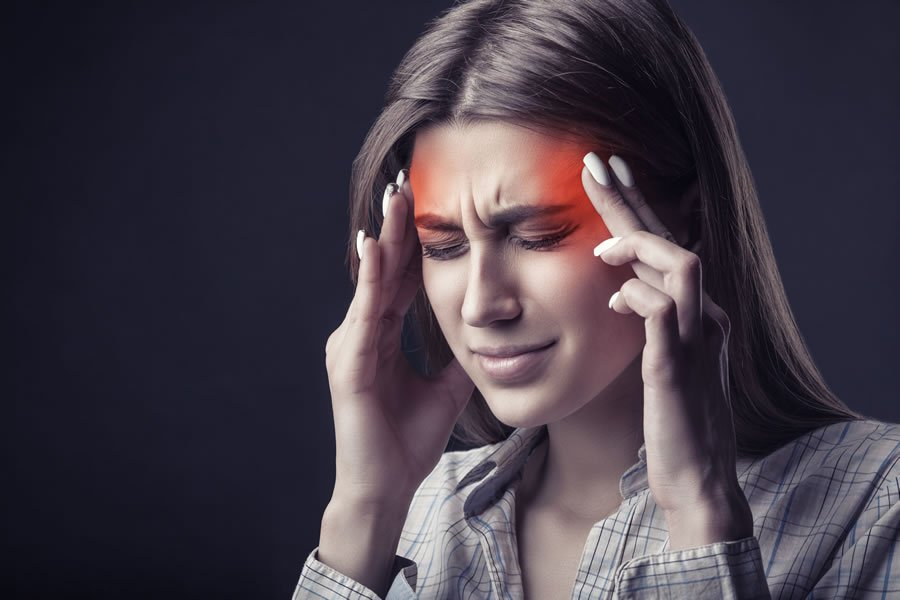 A woman suffering from severe migraines and headaches