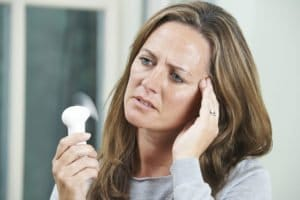 A middle aged woman suffering from perimenopause