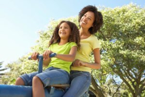 Mother and daughter playing in the park. Hormone balancing is very important for a woman's health