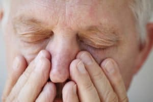 Man suffering from sinusitis. Ozone is good for sinuses