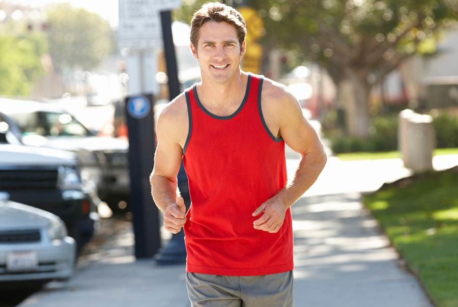 A healthy man running in the park. We treat prostate naturally