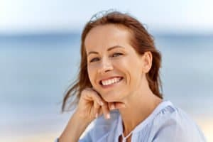 Happy Woman after Receiving Treatment for Thyroid Disease