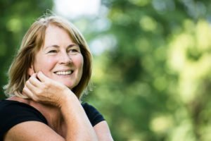 Happy Woman who got rid of chronic depression thanks to our treatments