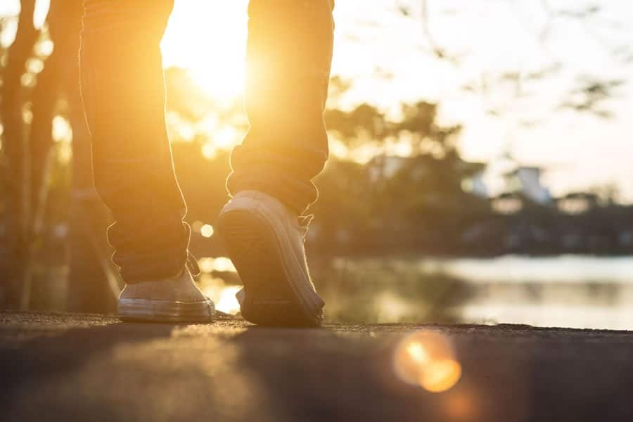A man walking in the park after having receivedProlotyherapy sessions for various chronic conditions