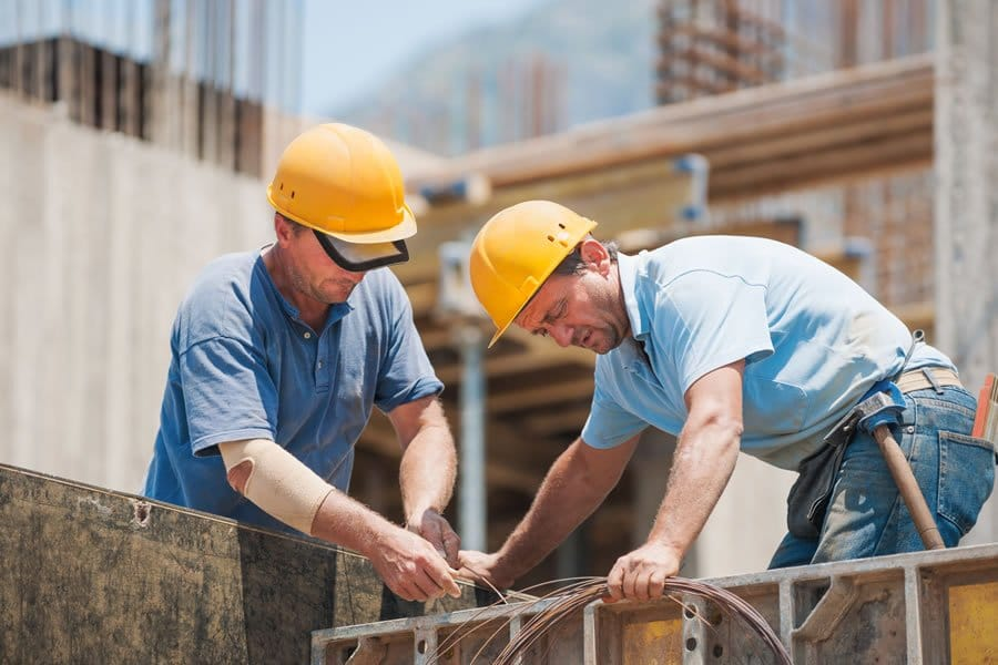 Image of two construction workers. We offer Prolozone treatment for various issues