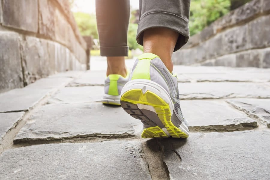Moving feet in sport shoes. We offer successful Ozone Therapy, IV & MAS Mat
