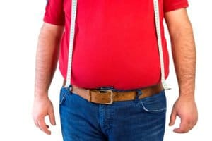 Man with belly fat suffering from Thyroid Conditions