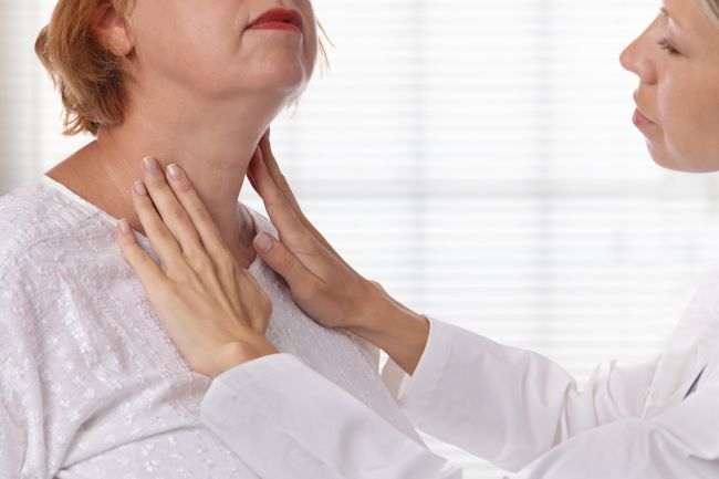 Woman with swollen neck, suffering from thyroid problems