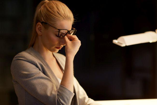 Woman suffering from Thyroid Symptoms
