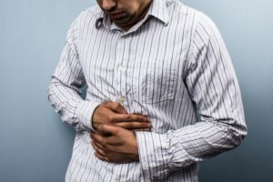 Multi racial man with constipation caused by GERD