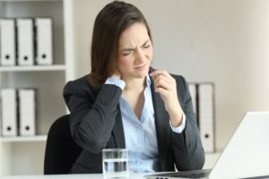 Young business woman suffering from fibromyalgia