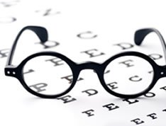 Patient's glasses on a vision test sheet.. LifeWorks offers efficient Ozone therapy that can improve your vision