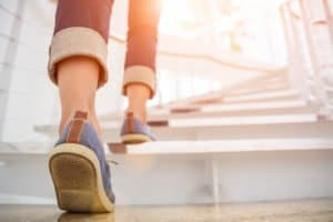 A person climbing stairs. We offer Prolozone therapy for many health issues
