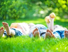 Happy family playing in the grass, thankful for successful treatment Jayme received at LifeWorks