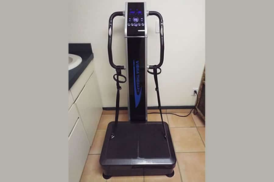 The Vibra-Plate machine is a plate with bars that one holds onto and it actually vibrates.