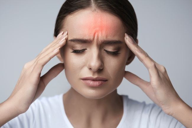 Young woman suffering from migraine