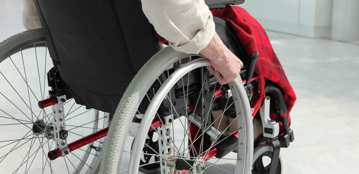 Person in a wheel chair, suffering from multiple sclerosis