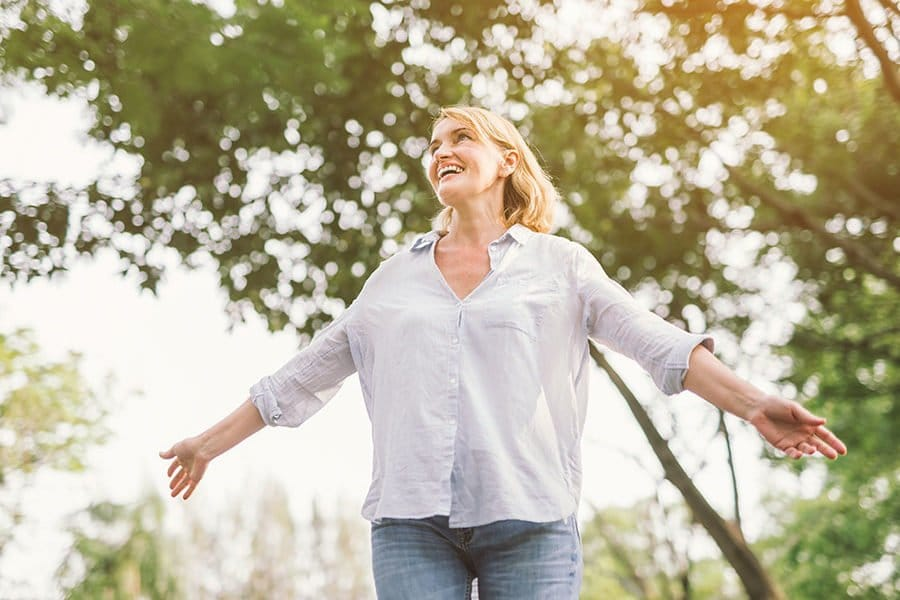 Happy middle aged woman after having recovered from her chronic condition