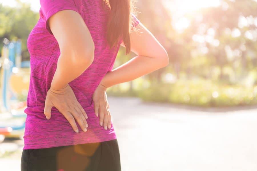 Woman with back pain in need of ourProlozone Therapy