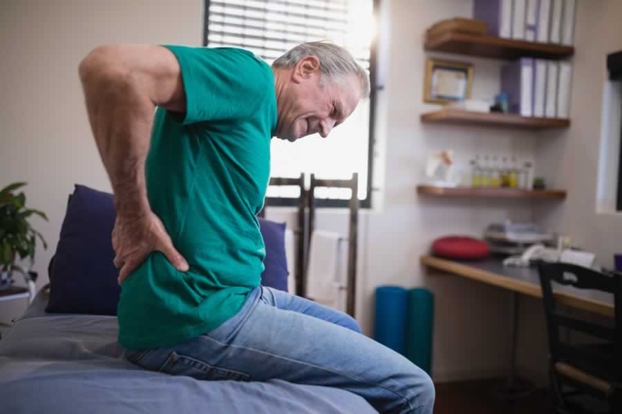 A man with severe pain. We offer hip pain therapies