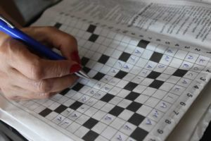 A person solving a crossword puzzle.We offer Brain Fog alternative treatments