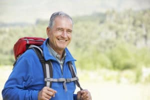A happy elderly man who has received HBOT therapy, which improved his energy and activity levels!